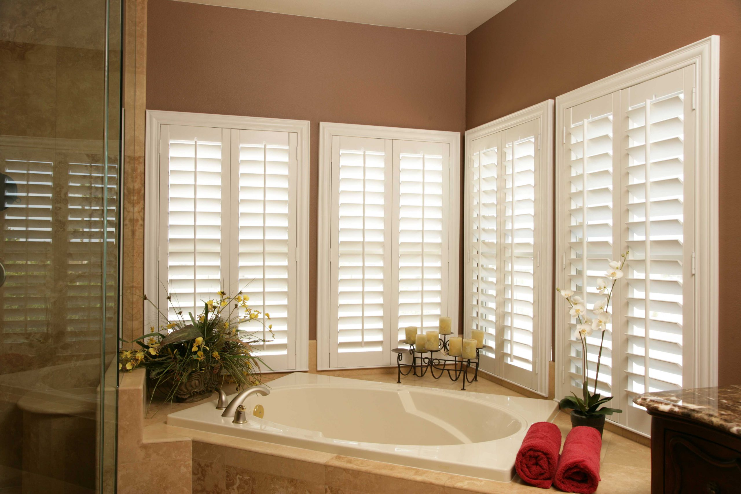 bathroom windows with elegant inside shutters