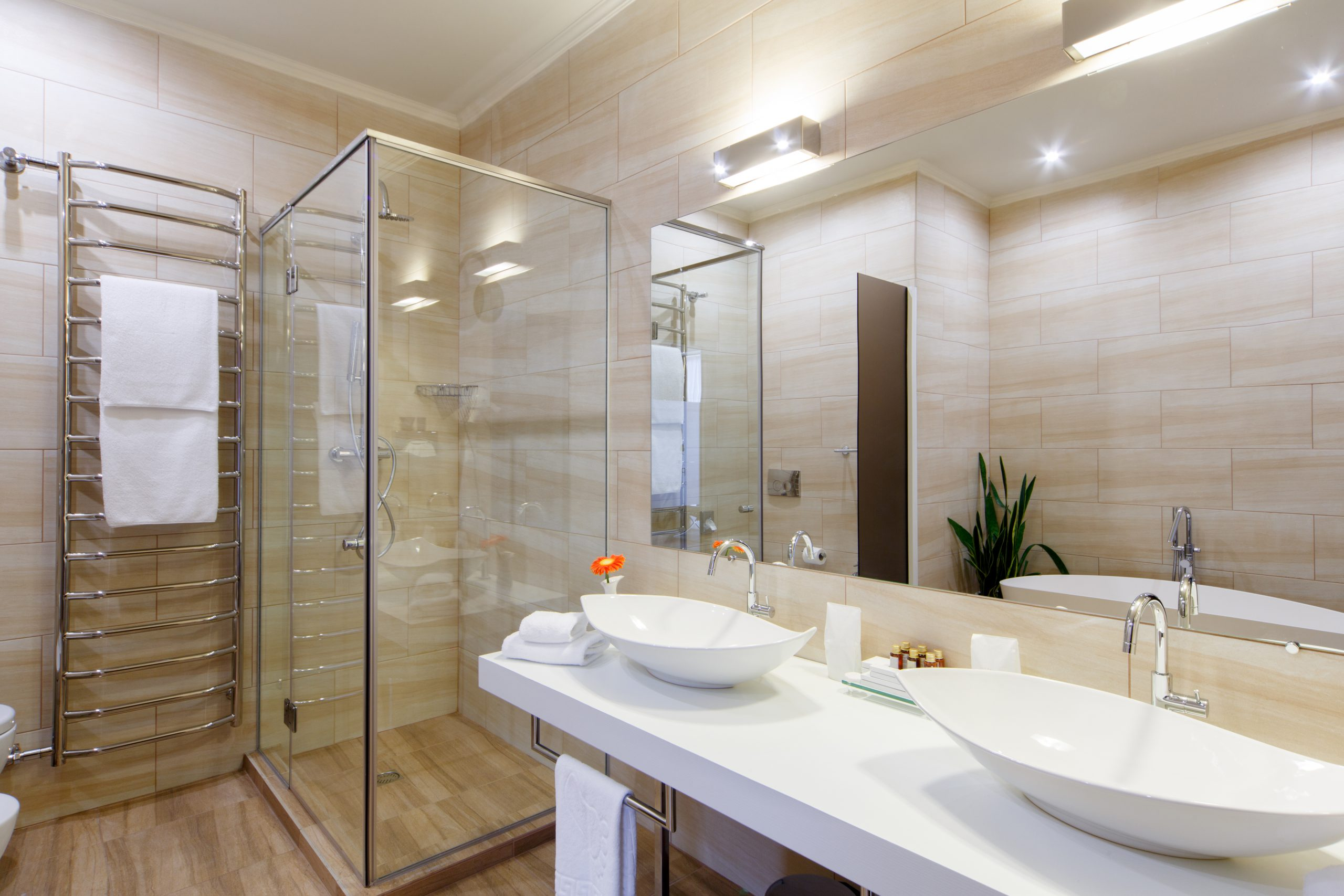 double sink bath with open glass shower