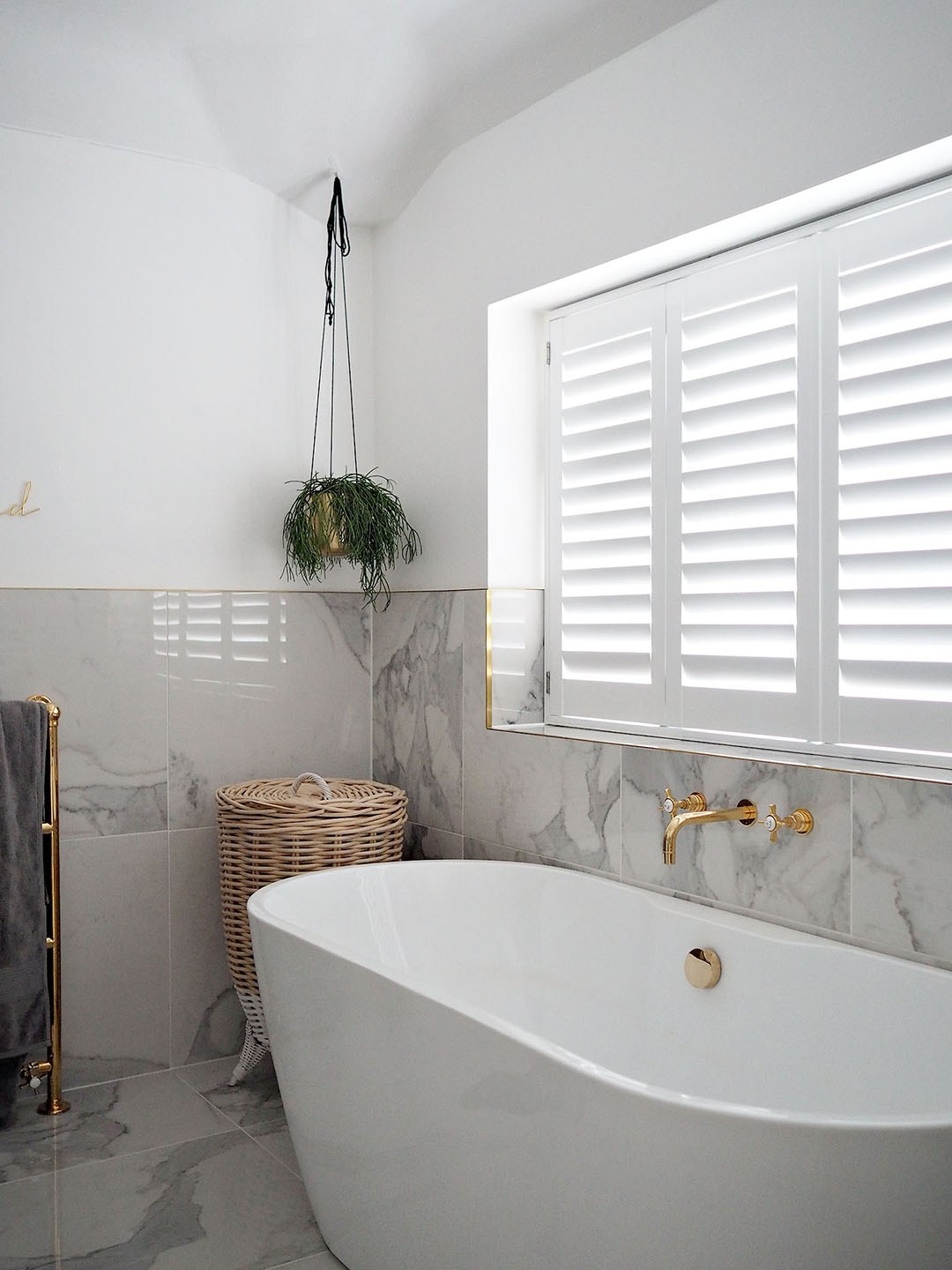 luxury marble bathroom with windows shutters